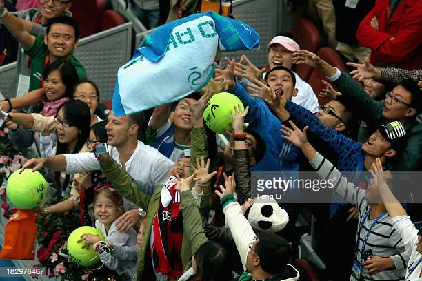 Chinese fans try to catch Novak Djokovic's towel after his men's singles match against Fernando Verdasco of Spain on day six of the 2013 China Open...
