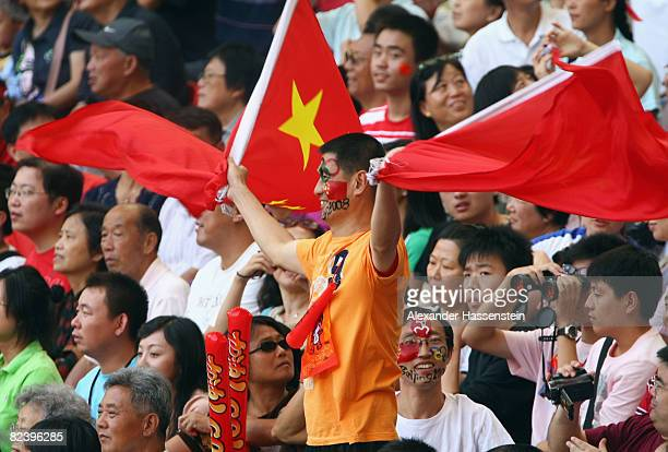 Chinese fans wave a flag at the National Stadium on Day 10 of the Beijing 2008 Olympic Games on August 18 2008 in Beijing China