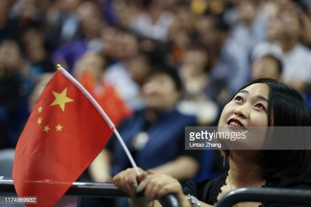 Chinese fans waves a Chinese flag during a preseason game between the Los Angeles Lakers and Brooklyn Nets as part of 2019 NBA Global Games China at...