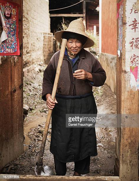 Chinese farmer standing in the doorway of her house on July 18, 2011 in Dali, China.