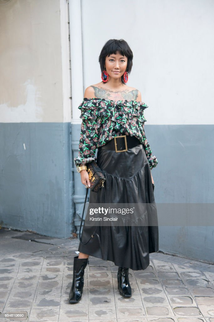 Chinese fashion blogger Carrie Lee wears Dior skirt and top Louis Vuitton bag, Balenciaga shoes and earrings she made herself day 1 of Paris Womens Fashion Week Spring/Summer 2018, on September 26, 2017 in Paris, France.