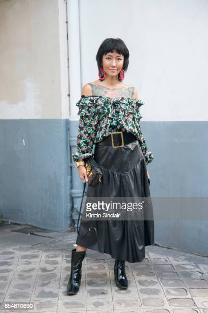 Chinese fashion blogger Carrie Lee wears Dior skirt and top Louis Vuitton bag Balenciaga shoes and earrings she made herself day 1 of Paris Womens...