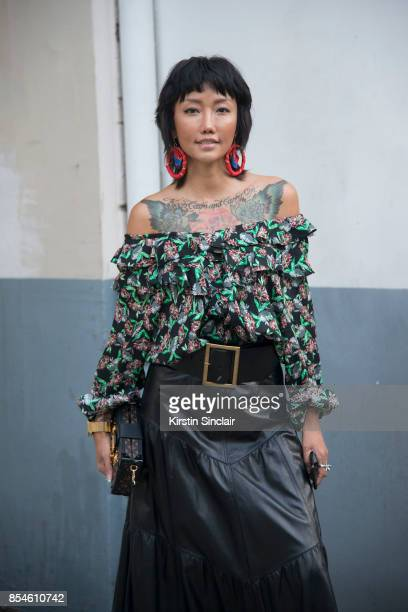 Chinese fashion blogger Carrie Lee wears Dior skirt top and earrings Louis Vuitton bag day 1 of Paris Womens Fashion Week Spring/Summer 2018 on...