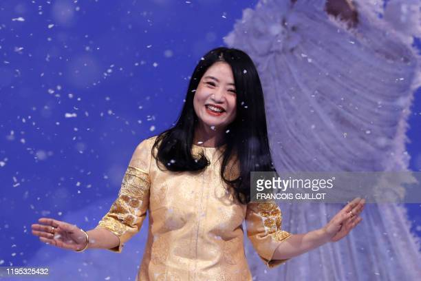 Chinese fashion designer Guo Pei acknowledges the audience at the end of the Women's Spring-Summer 2020 Haute Couture collection fashion show in...