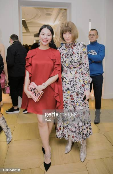 Chinese fashion investor Wendy Yu and US Vogue editorinchief Anna Wintour attend the 'Americans In Paris' cocktail party as part of the Paris Fashion...