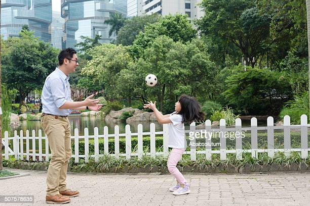 Chinese Father and Daughter Playing with Ball, Hong Kong