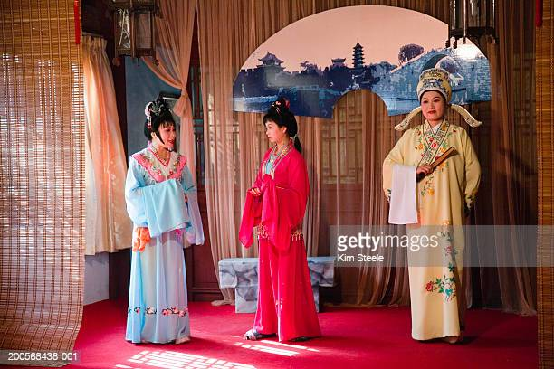 Chinese female actors performing traditional play