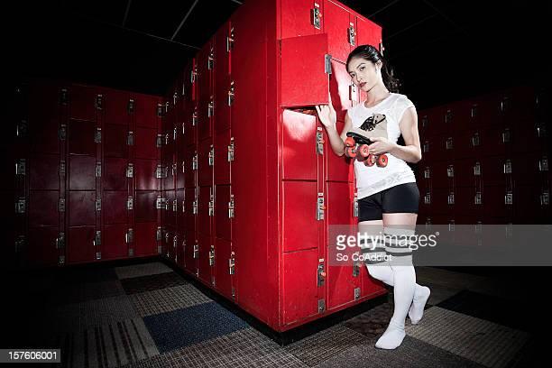 Chinese Female Holding Roller Skate In Locker Room