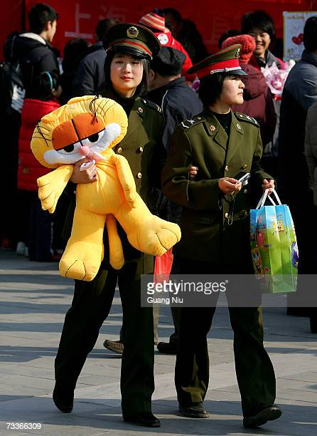 Chinese female soldiers visit a temple fair to mark Chinese New Year February 19 2007 in Beijing China China continues to celebrate the Chinese Lunar...