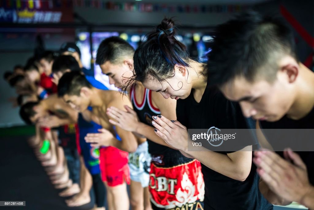 Chinese fighter Lin Heqin attends a Thai boxing training at