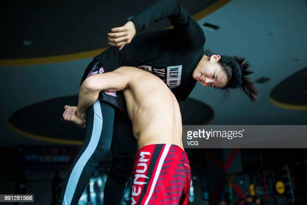 Chinese fighter Lin Heqin exercises with her teammate at Guangdong Olympic Centre Stadium on November 29 2017 in Guangzhou Guangdong Province of...