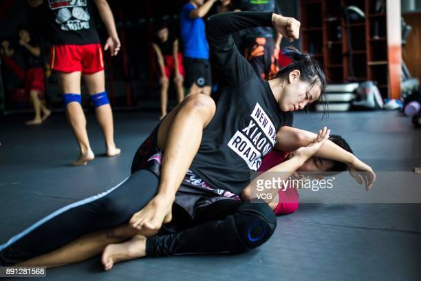 Chinese fighter Lin Heqin exercises with her teammate Zhou Xiaolong at Guangdong Olympic Centre Stadium on November 29 2017 in Guangzhou Guangdong...