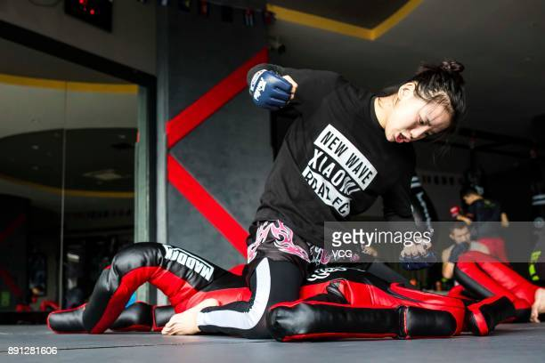Chinese fighter Lin Heqin in action during a wrestling training at Guangdong Olympic Centre Stadium on November 29 2017 in Guangzhou Guangdong...