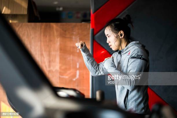 Chinese fighter Lin Heqin waves arms while running on machine at Guangdong Olympic Centre Stadium on November 29 2017 in Guangzhou Guangdong Province...