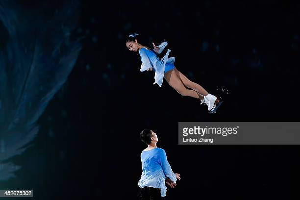 Chinese Figure Skater Jin yang and Yu Xiaoyu performs during the 2014 Artistry On Ice Beijing at Beijing MasterCard Center on July 25 2014 in Beijing...