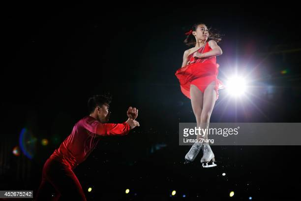 Chinese Figure Skater Peng Cheng and Zhang Hao performs during the 2014 Artistry On Ice Beijing at Beijing MasterCard Center on July 25 2014 in...