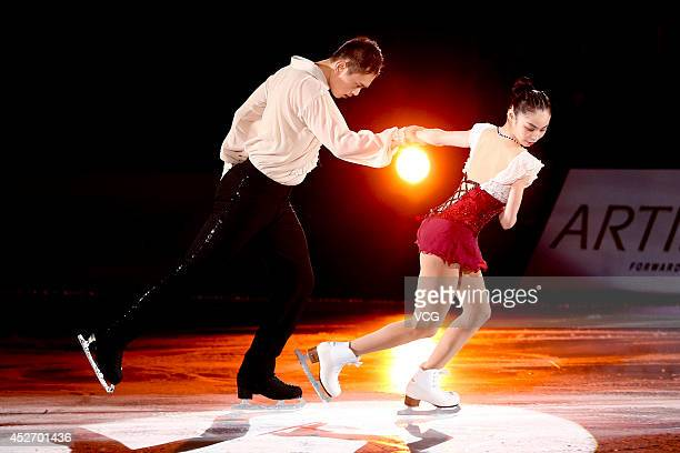 Chinese figure skaters Yu Xiaoyu and Jin Yang perform during Artistry On Ice 2014 at MasterCard Center on July 25 2014 in Beijing China
