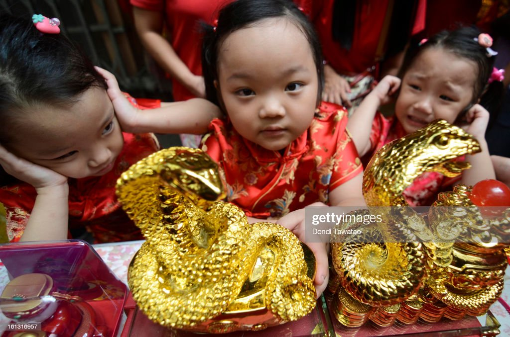Chinese Filipino children cover their ears amid the sound of fireworks during the celebration of the Chinese New Year in the district of Binondo on February 10, 2013 in Manila, Philippines. The Chinese New Year (the year of the snake) has begun, known by locals as 'Spring Festival' or 'Lunar New Year'and is being celebrated annually by Chinese Filipinos who make up roughly 20 percent of the local population.