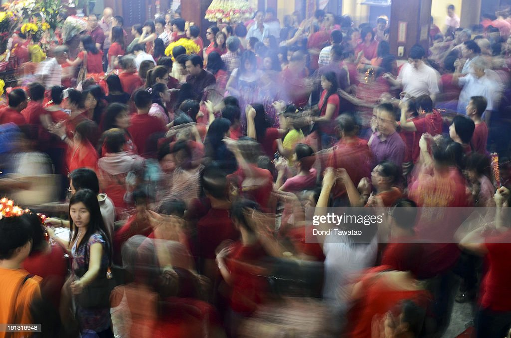 Chinese Filipinos pray at the Seng Guan Temple during the celebration of the Chinese New Year in the district of Binondo on February 9, 2013 in Manila, Philippines. The Chinese New Year (the year of the snake) has begun, known by locals as 'Spring Festival' or 'Lunar New Year'and is being celebrated annually by Chinese Filipinos who make up roughly 20 percent of the local population.