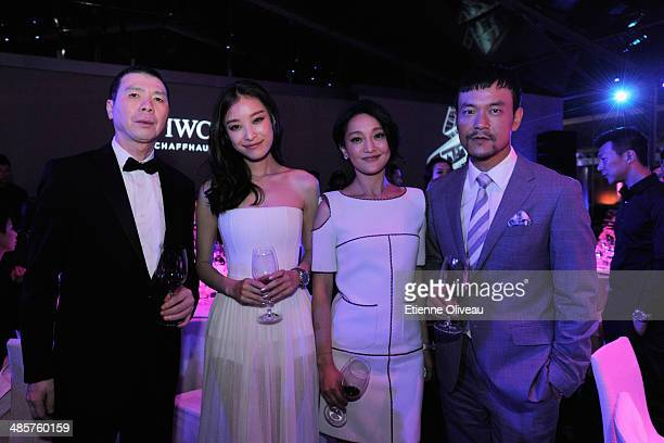 """Chinese film director Feng Xiaogang, actress Ni Ni, actress Zhou Xun, and actor Liao Fan attend the exclusive """"For the Love of Cinema"""" hosted by IWC..."""