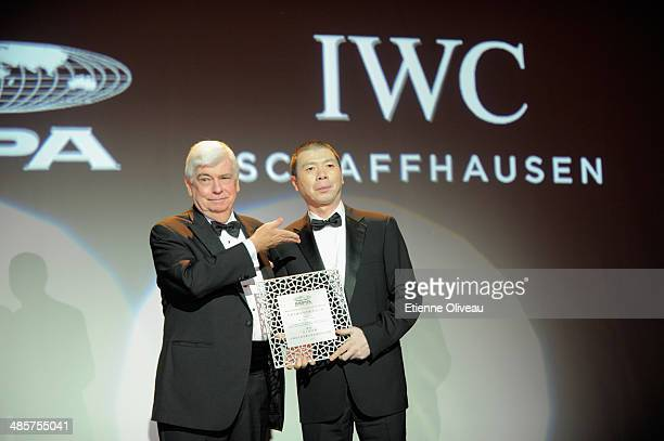 Chinese film director Feng Xiaogang is presented with the IWC Filmmaker Award by Chairman and CEO of MPA Chris Dodd during the exclusive gFor the...
