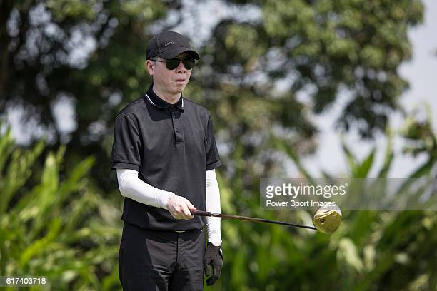 Chinese film director Feng Xiaogang tees off during the World Celebrity ProAm 2016 Mission Hills China Golf Tournament on 22 October 2016 in Haikou...