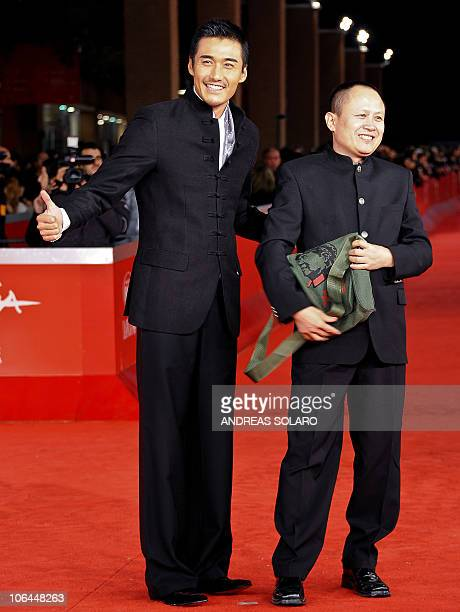 Chinese film director Liu Bingjian stands nex to actor actor Hu Bing on the red carpet before the showing of The Back at the fifth Rome Film Festival...