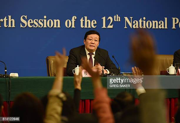 Chinese Finance Minister Lou Jiwei takes questions during a National People's Congress press conference in Beijing on March 7 2016 China's labour...