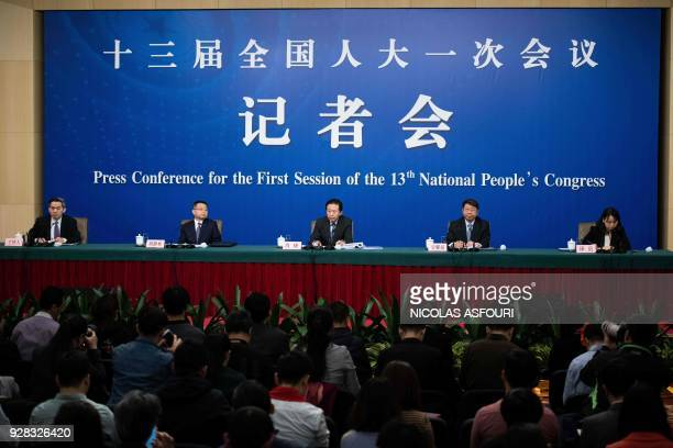 chinas finance minister xiao jie speaks at news conference ストック