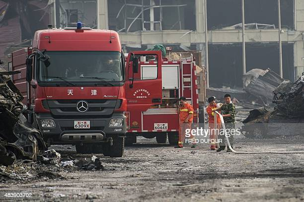 Chinese firefighters continue operations the second morning after a series of explosions at a chemical warehouse hit the city of Tianjin in northern...