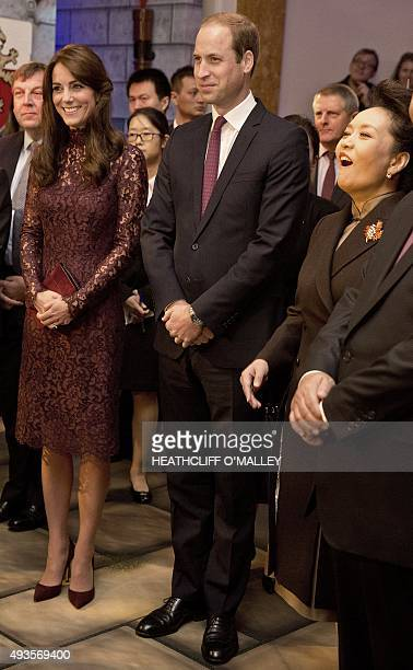 Chinese First Lady Peng Liyuan Britain's Prince William Duke of Cambridge and his wife Britain's Catherine Duchess of Cambridge react during a...