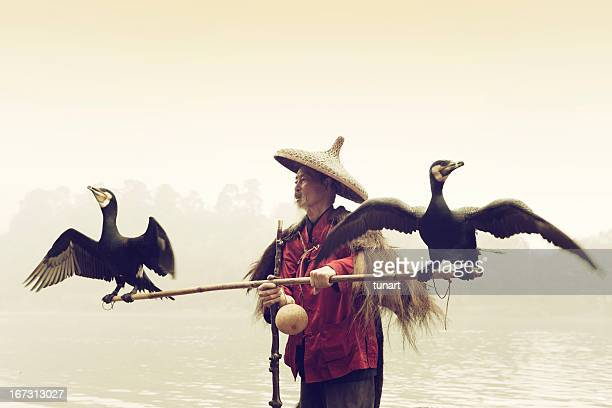 Chinese Fisherman With His Cormorants, Li river, Yangshuo, Guilin, China