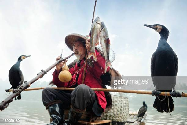 Chinese Fisherman With His Cormorants