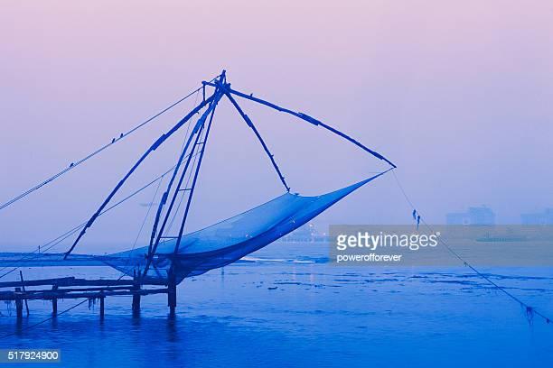 Chinese fishing net at sunrise in Kochi, India