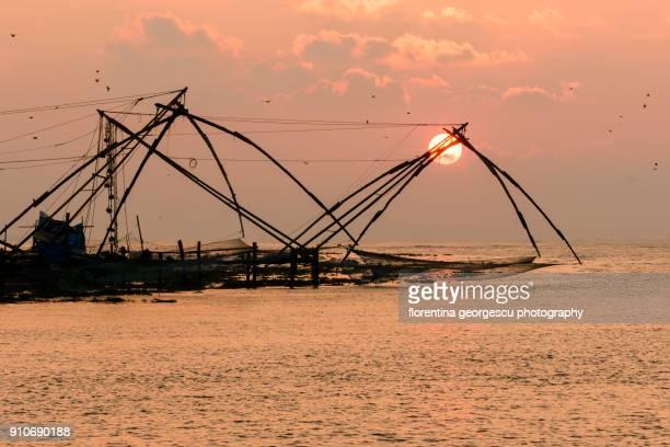 Chinese fishing nets at sunset, Fort Kochi, Kerala, India