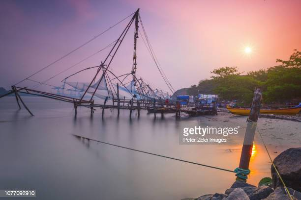 chinese fishing nets in fort kochi, kerala, india - kochi india stock pictures, royalty-free photos & images