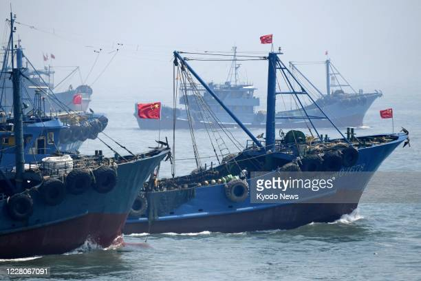 Chinese fishing vessels leave a port in Shishi in Fujian Province on Aug 16 2020 A Chineseset suspension of fishing in the East China Sea ended the...