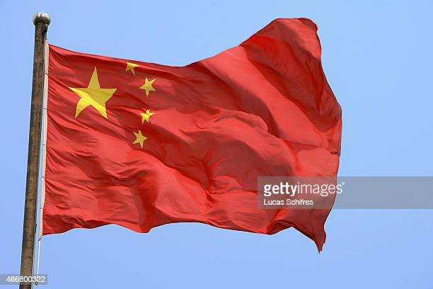 A Chinese flag flies on July 27 2007 in Shanghai China