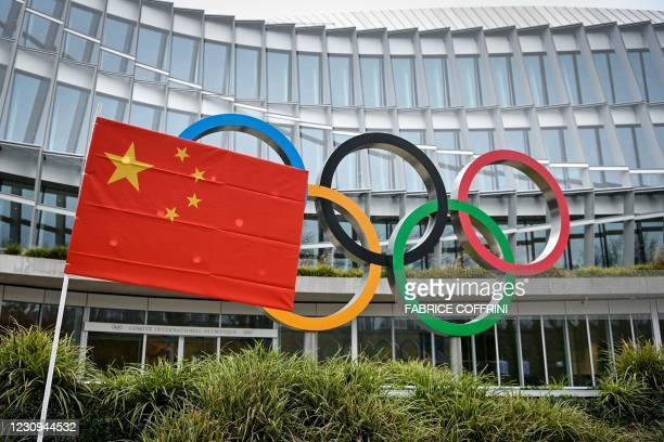 Chinese flag flutters in front of the IOC headquarters during a protest by activists of the International Tibet Network against the Beijing 2022...