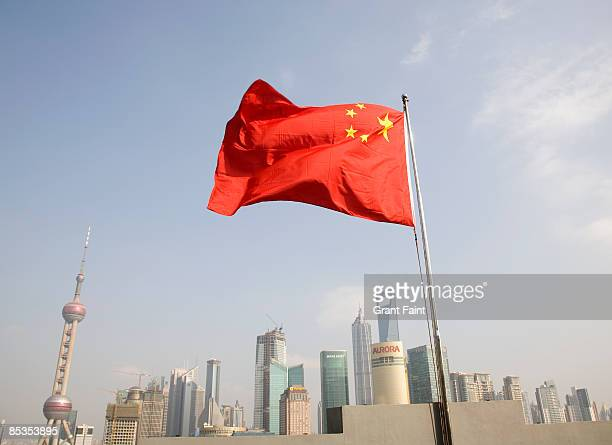 Chinese flag flying with view of city below