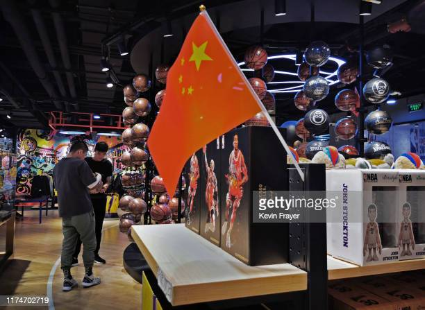 A Chinese flag is seen placed on merchandise in the NBA flagship retail store on October 9 2019 in Beijing China The NBA is trying to salvage its...
