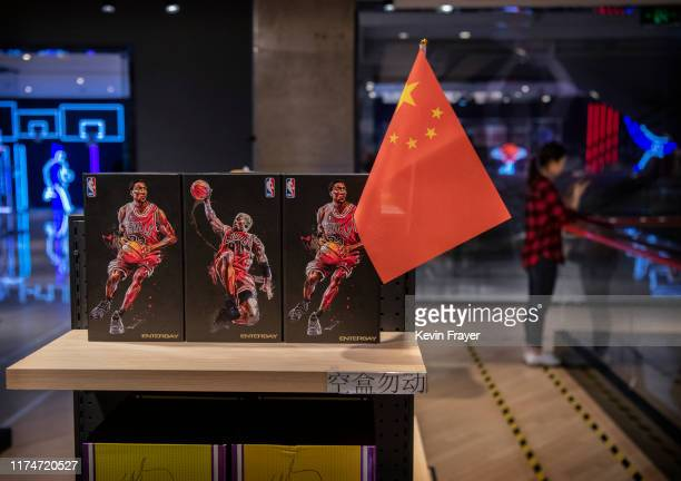 Chinese flag is seen placed on merchandise in the NBA flagship retail store on October 9 2019 in Beijing China The NBA is trying to salvage its brand...
