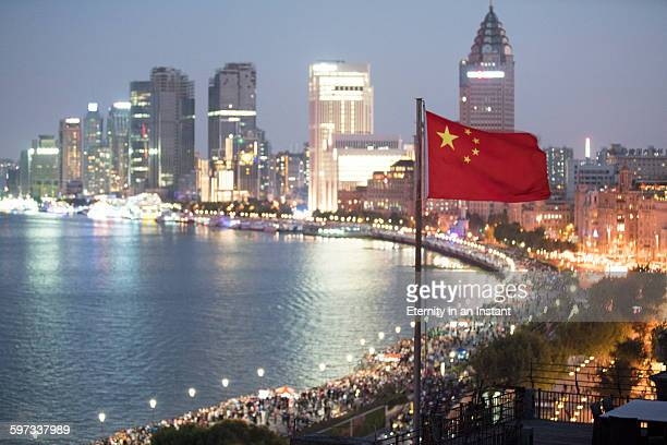 chinese flag waving in front of shanghai cityscape - chinese flag stock pictures, royalty-free photos & images