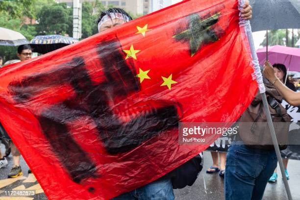 Chinese flag with Nazi symbol stands for quotChinazyquot during a protest on September 29 in support of Hong Kong Protesters in Taiwan