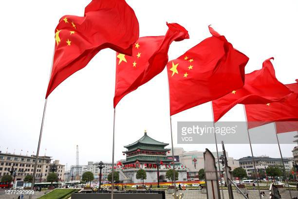 Chinese flags fly in front of the Bell Tower to mark upcoming Chinese National Day on September 27, 2020 in Xi an, Shaanxi Province China.