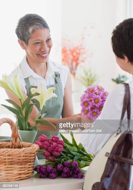 Chinese florist giving flowers to customer