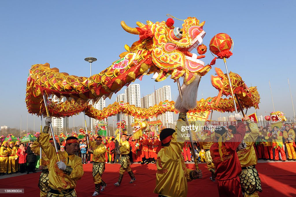 chinese folk artists perform a dragon dance to celebrate the chinese new year on february 1 - Chinese New Year 2012