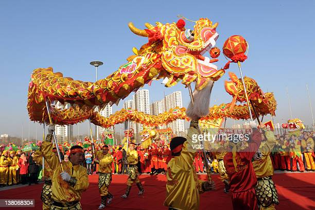 Chinese folk artists perform a dragon dance to celebrate the Chinese New Year on February 1 2012 in Taiyuan China The Lunar New Year or Spring...