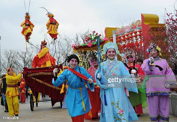 Chinese folk artists perform during first day of 8day Shanghai Longhua Temple Fair at Xuhui Riverside Area on April 3 2011 in Shanghai China The...