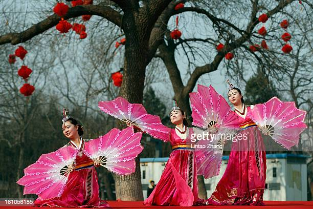 Chinese folk artists perform during the opening ceremony of the Spring Festival Temple Fair at Dragon Lake Park on February 9, 2013 in Beijing,...